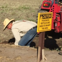 Dave Hedges installing one of new two new irrigation gates.